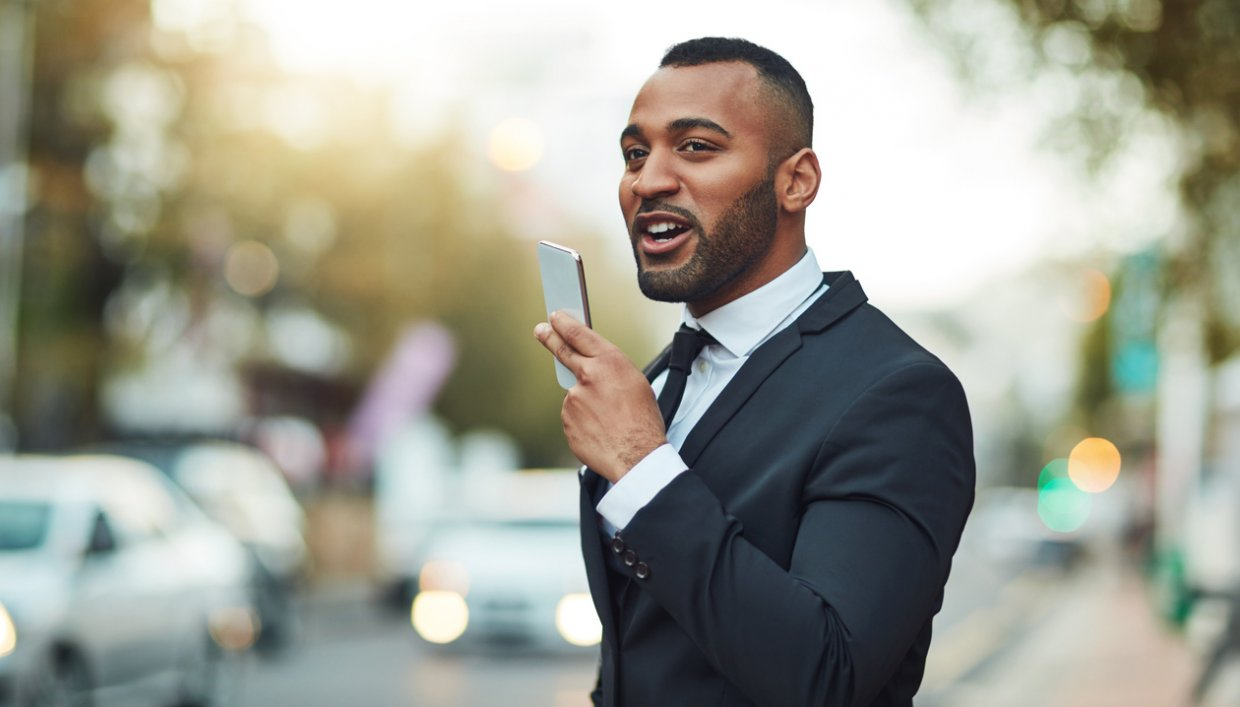 Man using voice search on his smartphone