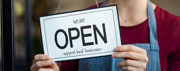 open sign for a business  that reopening