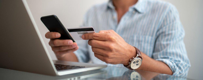 Business owner entering credit card number into smartphone