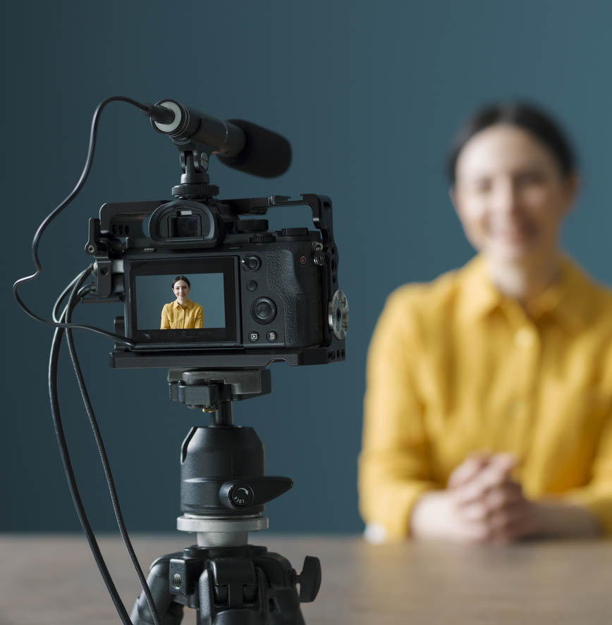 Business owner videotaping herself for low-budget marketing