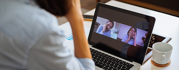 Employee wasting time with co-workers on laptop video call